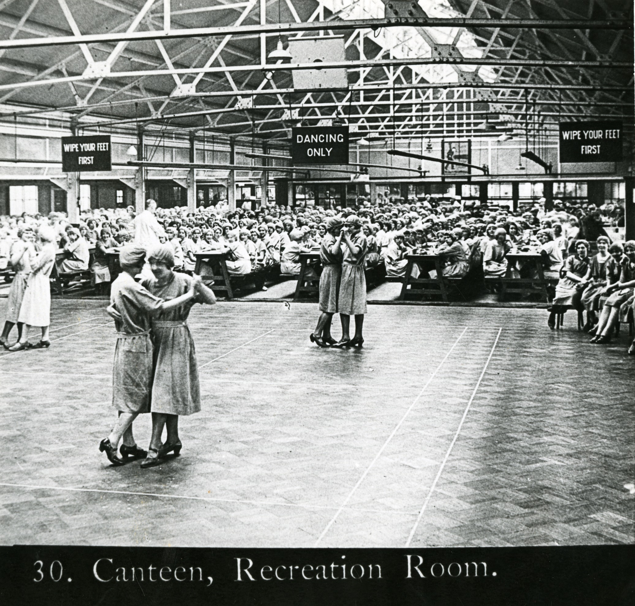 Black and white photograph of female workers in the Jacob's canteen/ recreation room.